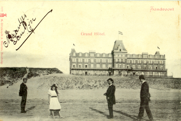 Beachcombers posing for a photo in front of the Grand Hotel.