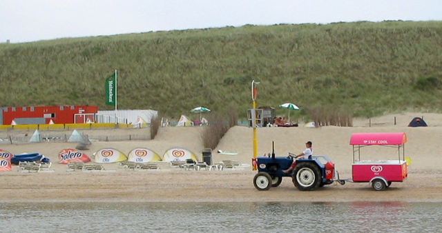 A passing ice cream vendor on Zandvoort beach.