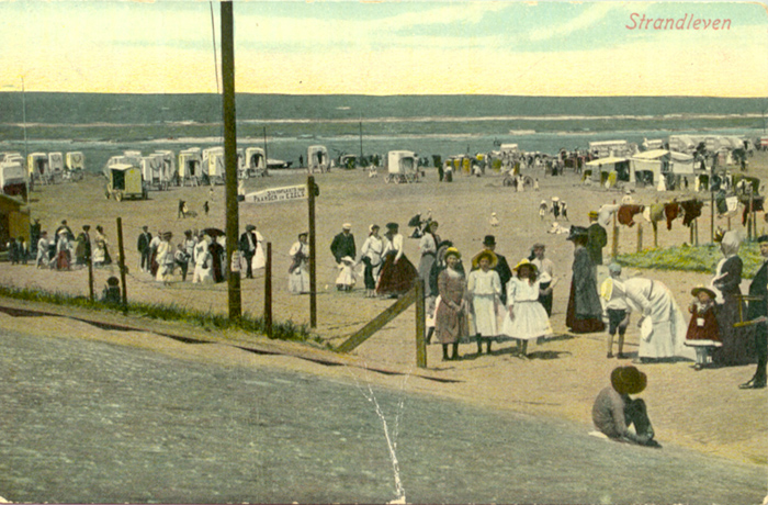 Three young ladies pose for a photo on this early Zandvoort colour postcard